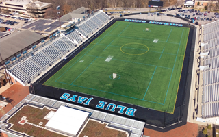 JOHNS HOPKINS UNIVERSITY PRACTICE FIELD GETTING NEW SHAW SPORTS TURF SURFACE IN TIME FOR SUMMER YOUTH SPORTS PROGRAMS