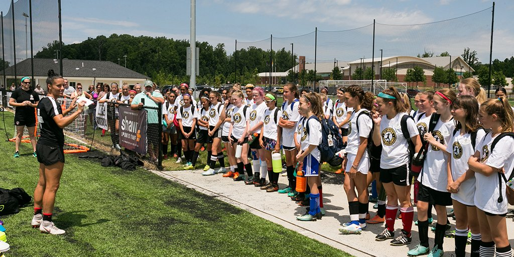 Veterans Day Sponsorship of Ali Krieger Football Camps By Shaw Sports Turf Image